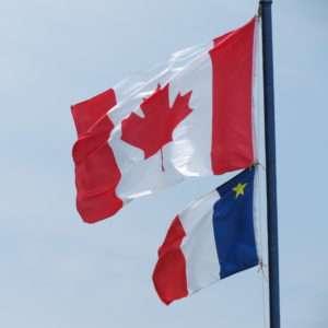 The Canadian Flag above the Acadian Flag