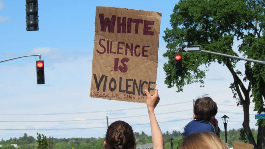 Sign at the rally. White Silence is Violence